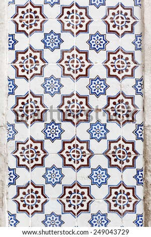 Blue and brown floral azulejos on the building's exterior in Lisbon, Portugal. - stock photo