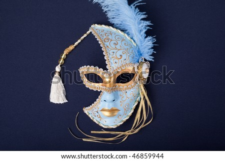 blue and gold feathered mask  on a black background