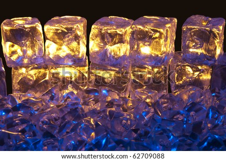 Blue and Gold Illuminated Ice Cubes on a Isolated Black Background
