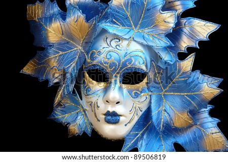 blue and gold venetian mask isolated on a black background - stock photo