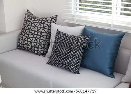 Blue And Graphic Cushion On Sofa
