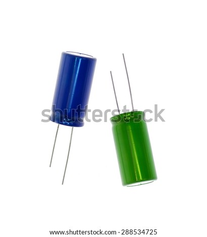 Blue and green electronic capacitor - stock photo