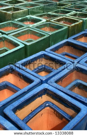 Blue and Green Terra Cotta Planters - stock photo