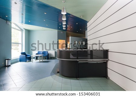 Blue and grey reception in a hallway of factory - stock photo