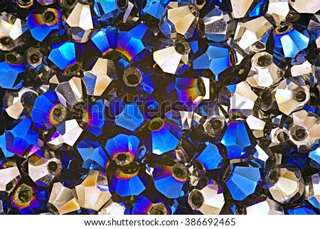Blue and metallic swarovski crystals beads close up