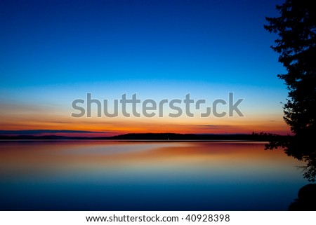 Blue and Orange Sunset on Beach - stock photo