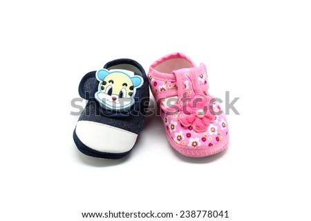 Blue and pink baby shoes isolated on white background - stock photo