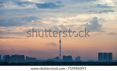 blue and pink dawning over Moscow city with Ostankino TV Tower and Timiryazevskiy park in summer morning
