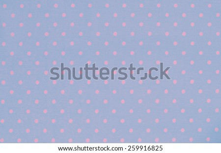 Blue and pink polka dot fabric for vintage background - stock photo