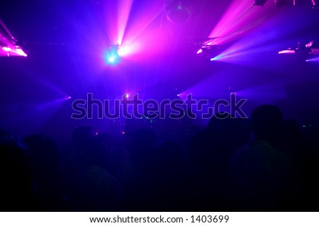Blue and purple lights at a night club. - stock photo