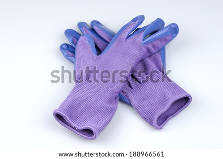 Blue and purple women's gardening gloves isolated on a white background with room for copy space.