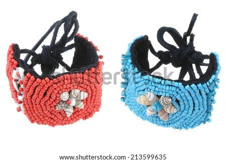 blue and red beads bracelets isolated on white background - stock photo