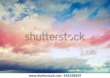 Blue and red cloudy sky photo background with toned filter effect - stock photo