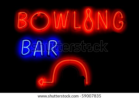 Blue and red neon sign of the words 'Bowling bar' with a left arrow, on a black background. - stock photo
