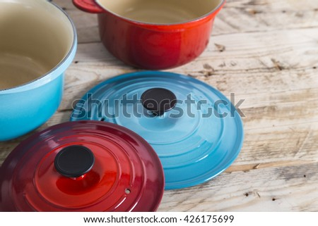 Blue and red saucepans and lids - stock photo