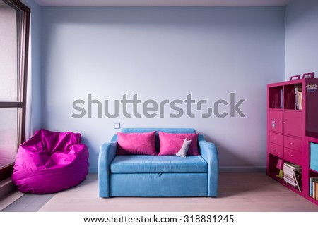 Blue and rose furniture in girl's room - stock photo