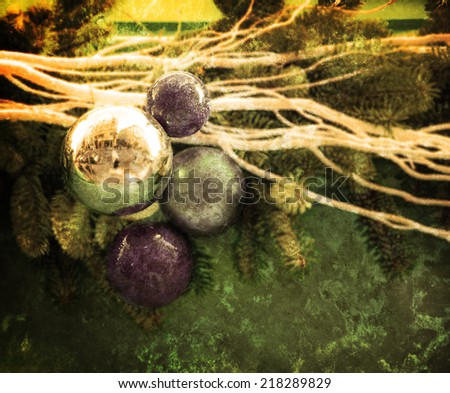 Blue and silver Christmas balls with a  reflection of Parisian street. Silver and Christmas tree twigs. Retro aged photo with scratches. - stock photo