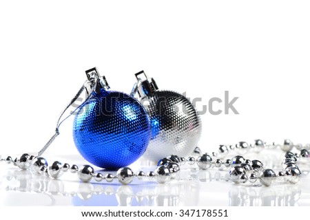 Blue and Silver Christmas balls with ornaments on white background.