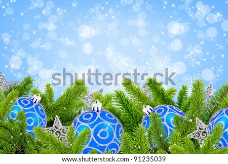 Blue and silver christmas decoration baubles and pine on festive background with space for text - stock photo