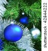 Blue and silver crystal balls on a Christmas tree - stock photo