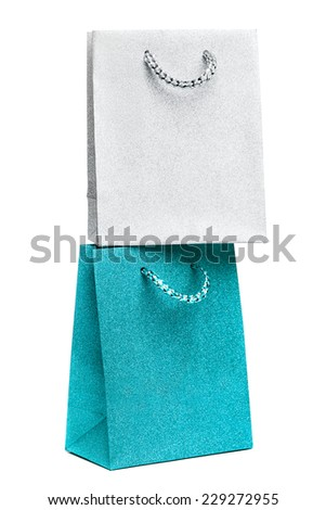 blue and silver gift bags on white background - stock photo