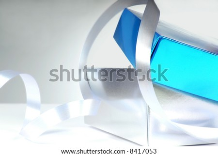 Blue and Silver gift box and ribbon - stock photo