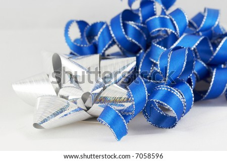 blue and silver ribbon and bow on white background