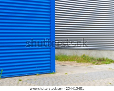blue and silver steel wall of an industrial building