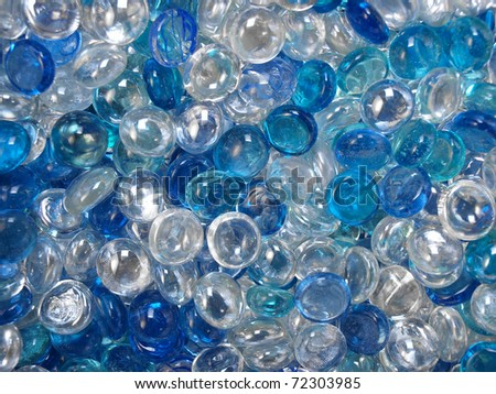 Blue and transparent glass marbles - stock photo