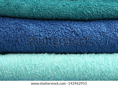 blue and turquoise bath towels stack - stock photo