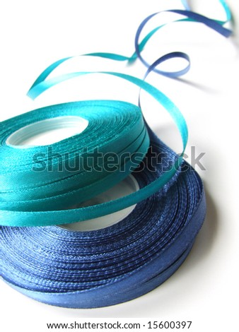 Blue and turquoise ribbons. - stock photo