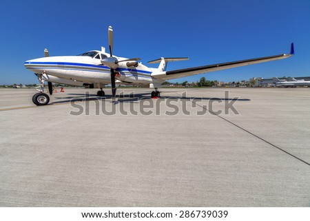 blue and white airplane staying in the airport - stock photo