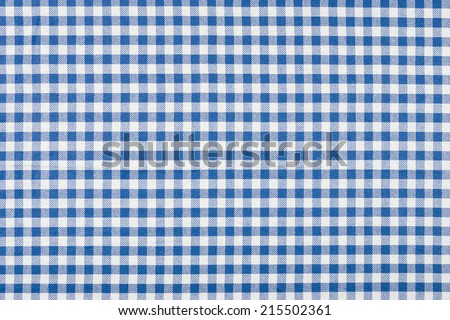 Blue and white checkered tablecloth - stock photo
