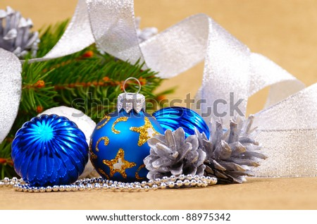 Blue and white Christmas balls over golden background