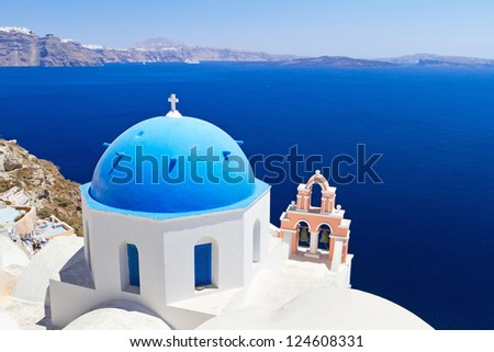Blue and white church of Oia village on Santorini island. Greece - stock photo