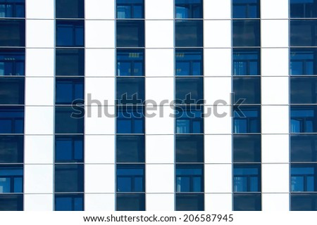 blue and white color windows of modern office building horizontal background - stock photo