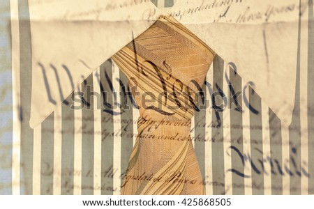 Blue and white cotton shirt and orange tie and Declaration of Independence - stock photo