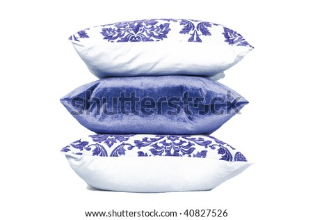 Blue and white cushions against white background - stock photo