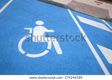 Blue and White Disabled Parking Sign