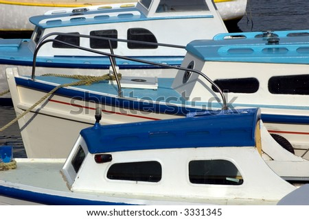 blue and white fishing boats