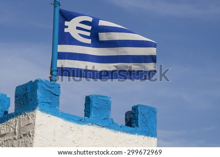 blue and white greek flag with a Euro currency sign on the tower of a castle. Financial concept for the greek Euro crisis - stock photo