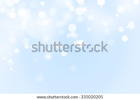 Blue and white ice and snow defocused bokeh background with copy space - stock photo