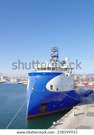 Blue and white inverted bow ship  in sunny day  - stock photo