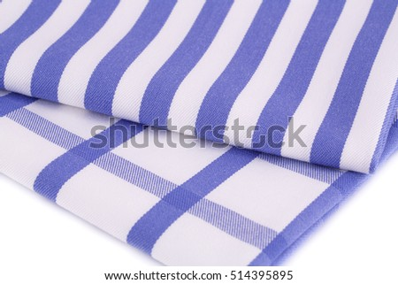 Blue and white kitchen towels closeup picture.
