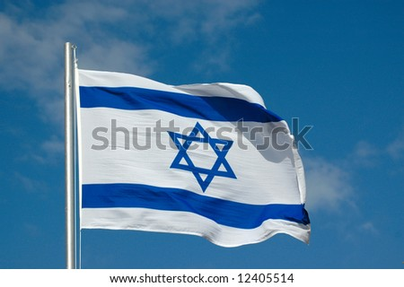 Blue and white national flag of Israel blowing in the wind