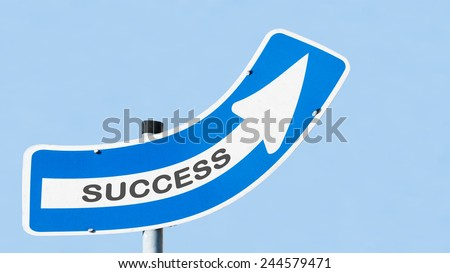 blue and white one-way street sign on a metal mast in front of the blue sky. Success is written on the white arrow, which points up to the sky. Business concept for success and motivation. - stock photo
