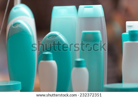 Blue and white  plastic bottles or containers for cosmetics - stock photo