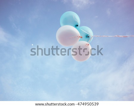 Blue and white romantic balloon on blue sky.