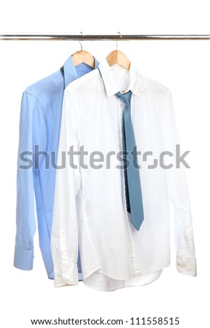 blue and white shirts with tie on wooden hanger isolated on white