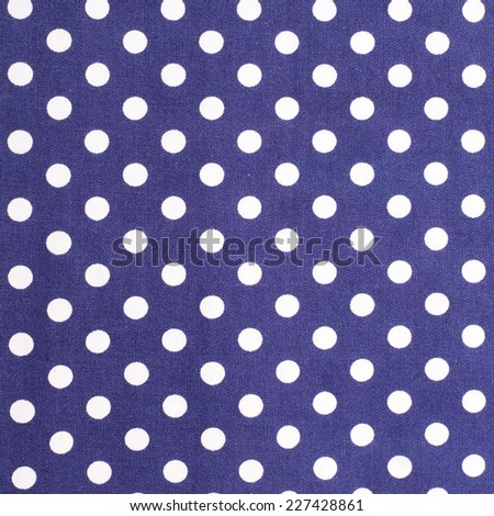 blue and white spotted textile - stock photo